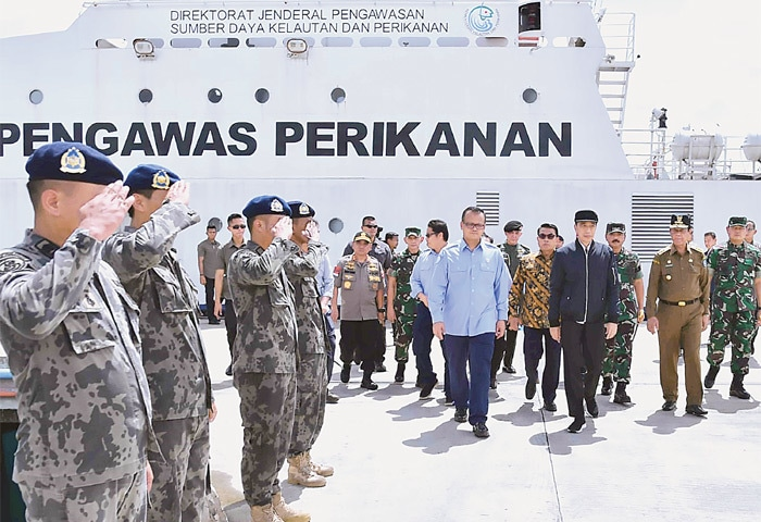 JAKARTA: This handout picture shows Indonesia's President Joko Widodo (fourth right) walking with officials during a visit to the Natuna islands, which border the South China Sea.—AFP