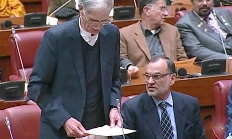 Defence Minister Pervez Khattak moves the bills for voting during the Senate session on Wednesday. — DawnNewsTV/File