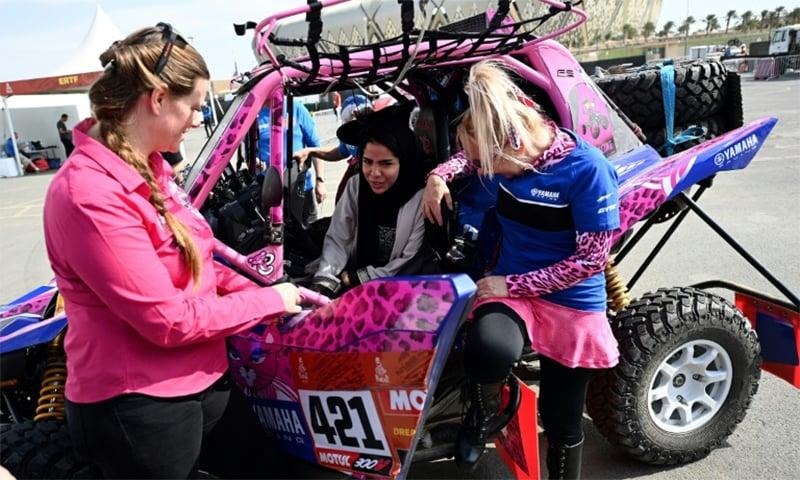 A Saudi woman dreams the dream while sitting in the car of Italian driver Camelia Liparoti. — AFP