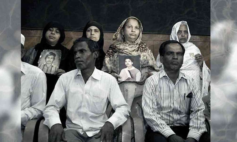 Relatives pose with photos of the Hashimpura massacre victims in New-Delhi. — Credit: HT Photo