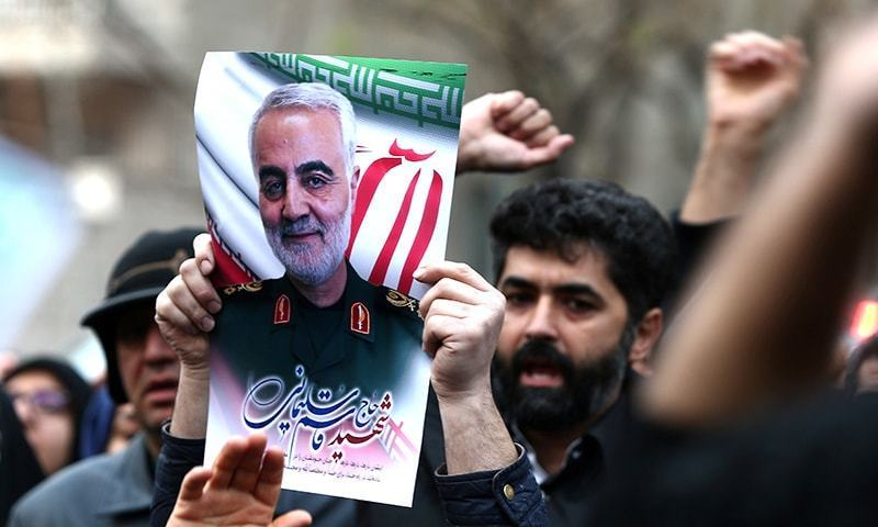 Iranian demonstrators chant slogans during a protest against the killing of the Iranian Maj Gen Qasem Soleimani, head of the elite Quds Force, and Iraqi militia commander Abu Mahdi al-Muhandis, who were killed in an air strike at Baghdad airport, in front of United Nations office in Tehran, Iran January 3. — WANA via Reuters/File