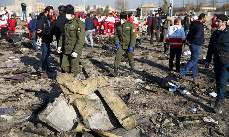 Security officers and Red Crescent workers are seen at the site where the Ukraine International Airlines plane crashed after take-off from Iran's Imam Khomeini airport, on the outskirts of Tehran, Iran on January 8, 2020. — Reuters