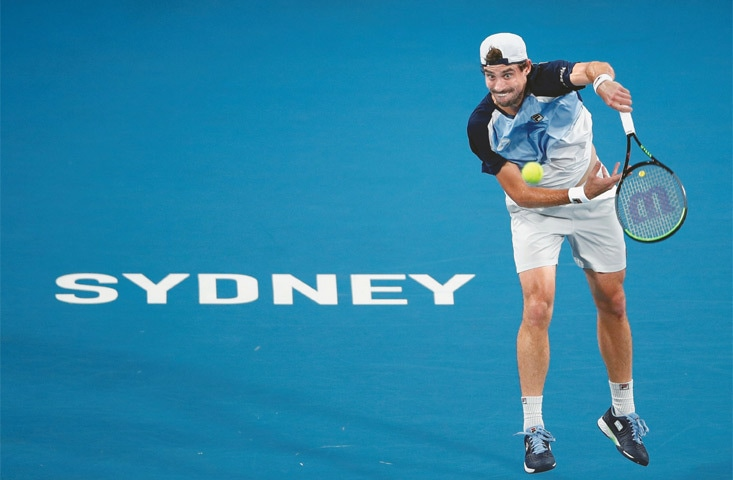 SYDNEY: Argentina's Guido Pella serves during the ATP Cup quarter-fnal against Karen Khachanov of Russia at the Ken Rosewall Arena on Thursday.—Reuters