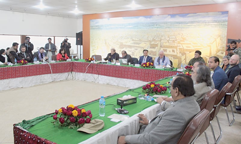 DELEGATES discuss advancement in deciphering Indus script at the inaugural session of the conference on Thursday.—Dawn