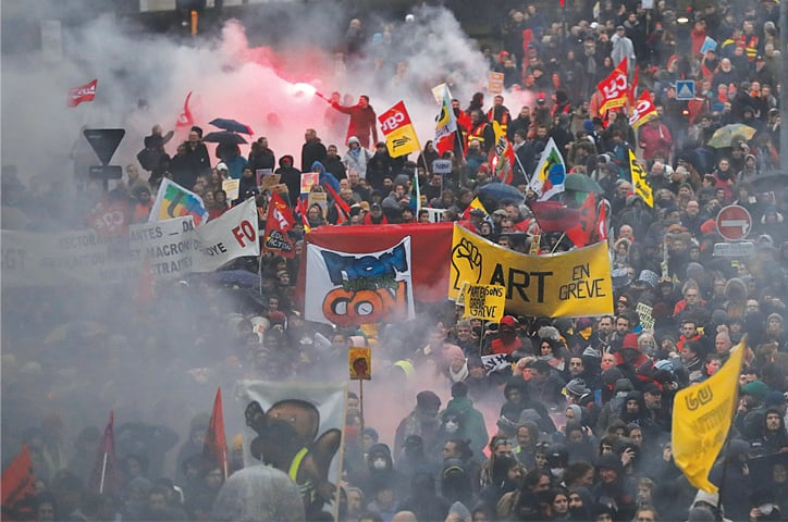 NANTES (France): Labour union members and workers attend a demonstration on Thursday during the 36th consecutive day of a strike against the government's pensions reform plans. Officials have said they are ready to negotiate the proposed reform.—Reuters