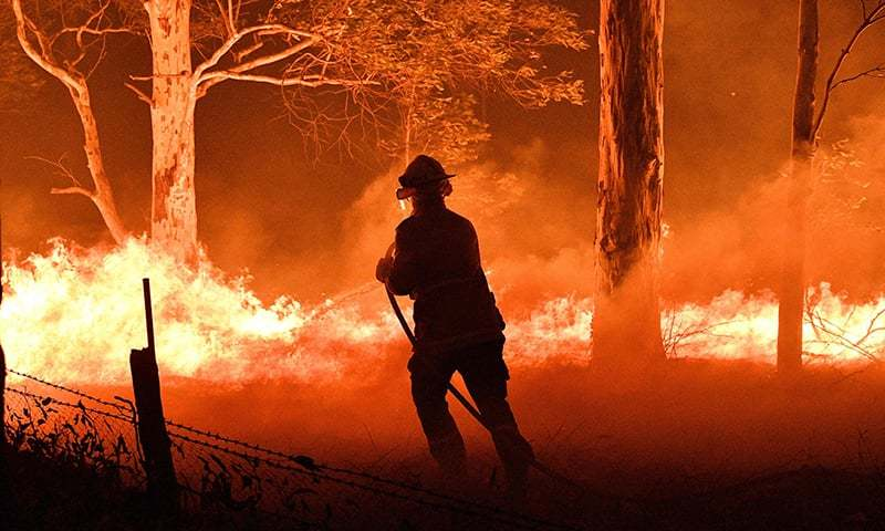Australia urges quarter of a million to flee as winds fan huge bushfires