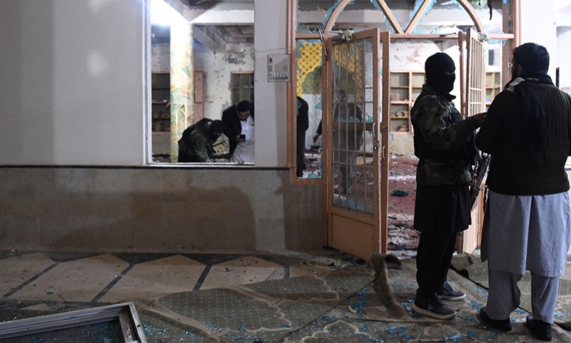 Security officials examine the site after a bomb blast in a mosque in Quetta on January 10. — AFP
