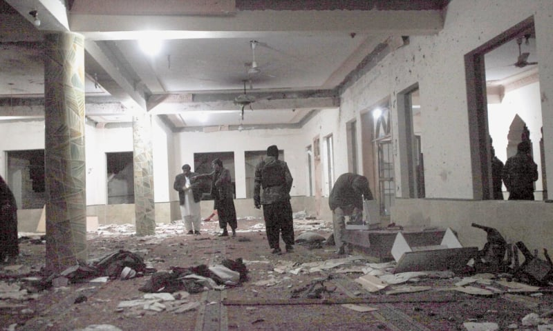 Security officials collect evidence after a powerful explosion ripped through a mosque in Quetta during evening prayers on Friday.—Online
