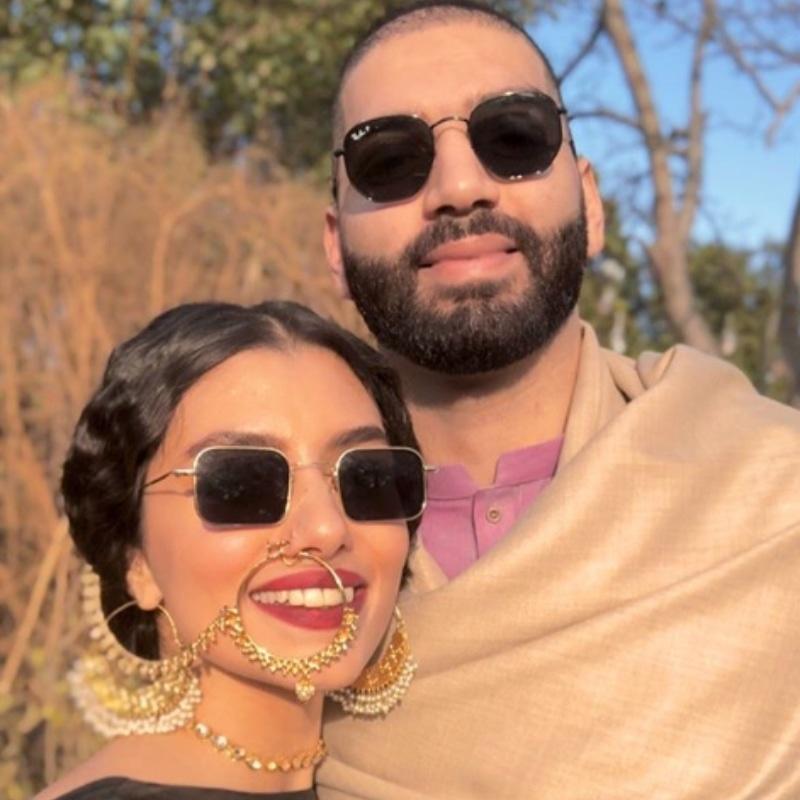 Bride's bestie pictured with the groom. —Photo via @zarapeerzada on Instagram