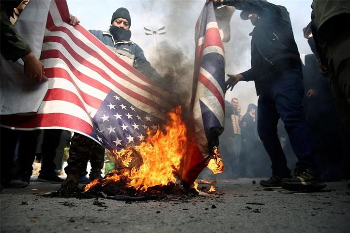 Demonstrators in Tehran burn US and British flags during a protest against the assassination of Qassem Soleimani | Reuters