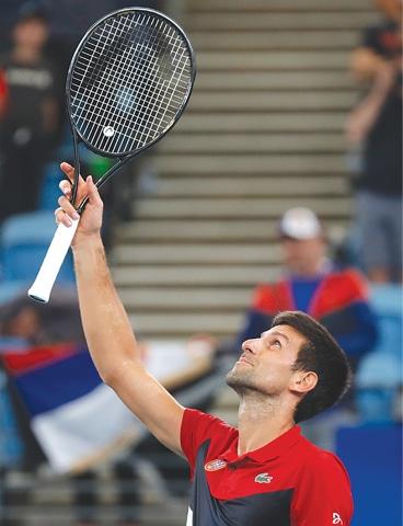 NOVAK Djokovic of Serbia celebrates winning his semi-final singles match against Russia's Daniil Medvedev.—Reuters