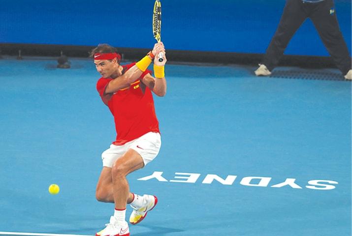 Rafael Nadal of Spain hits a return during his men's singles match against Alex de Minaur of Australia at the ATP Cup on Saturday.—AFP