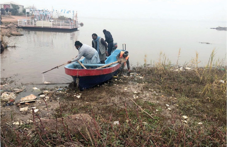 Officials from various departments involved in Rawal Dam's affairs participate in a drive to clean up the lake on Saturday.