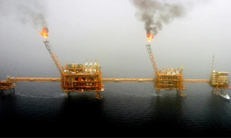 Gas flares from an oil production platform at the Soroush oil fields in the Persian Gulf, south of the capital Tehran.—Reuters file