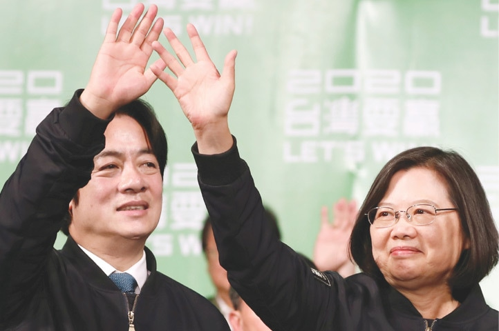 Taipei: Incumbent Taiwan President Tsai Ing-wen and Vice President-elect William Lai wave to their supporters after their election victory at a rally outside the Democratic Progressive Party headquarters on Saturday.—Reuters
