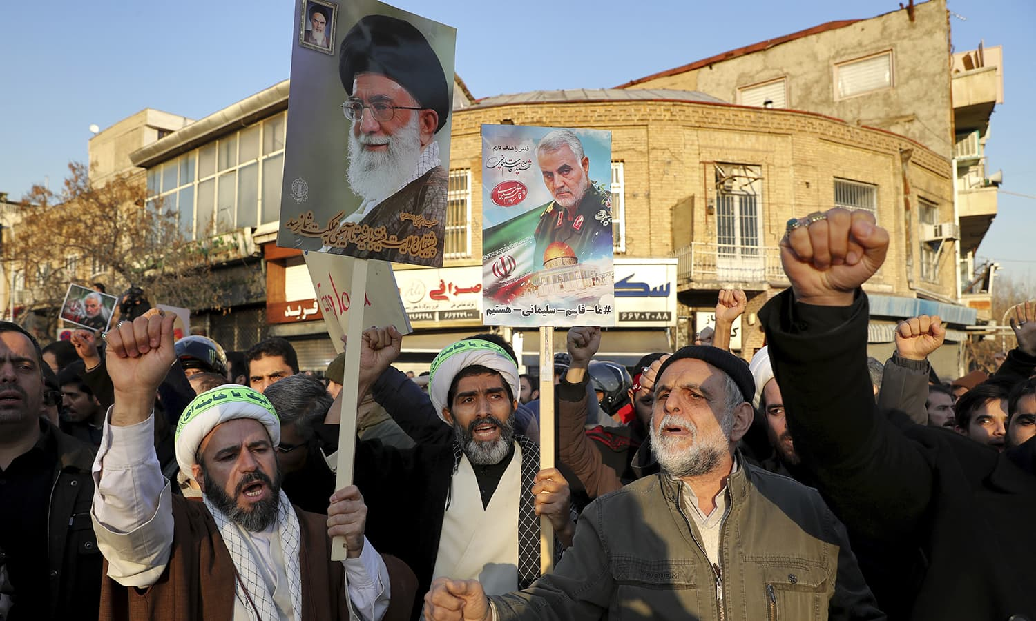 Hardline protesters chant slogans while holding up a poster of Gen Qassem Soleimani and Supreme Leader Ayatollah Ali Khamenei, during a demonstration in front of the British Embassy in Tehran. — AP/File