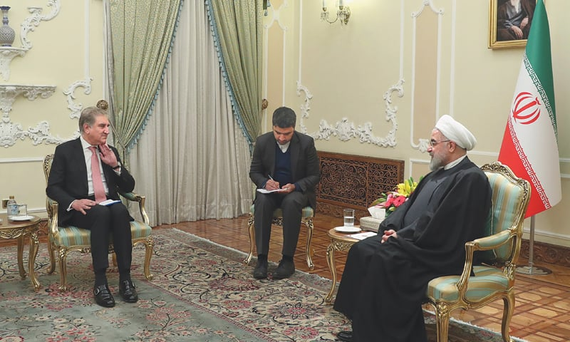 IN this photo released by the website of the Iranian Presidency, Foreign Minister Shah Mehmood Qureshi meets President Hassan Rouhani in Tehran on Sunday.—AP