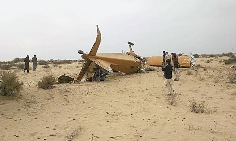 SADIQABAD: People gather around the wreckage of the single-engine plane.—Dawn