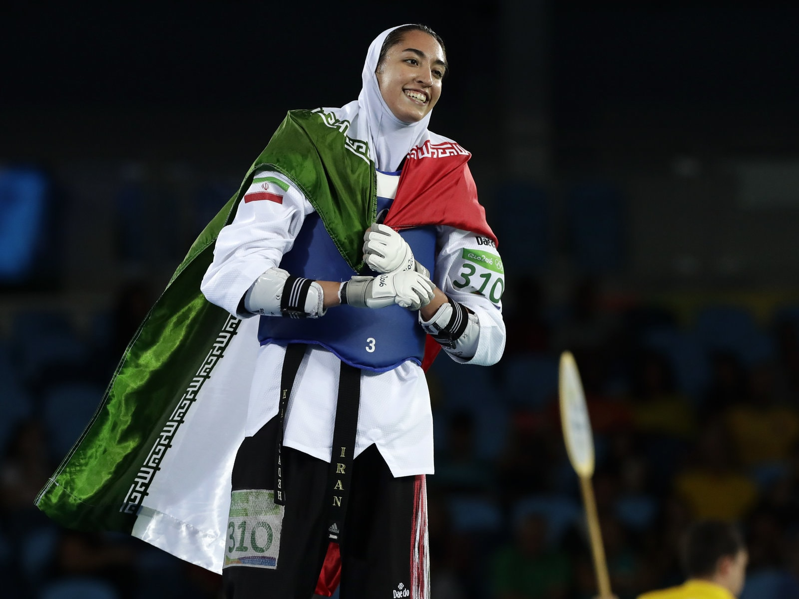 Kimia Alizadeh of Iran celebrates after winning a bronze medal in taekwondo at the 2016 Summer Olympics in Rio de Janeiro, Brazil.