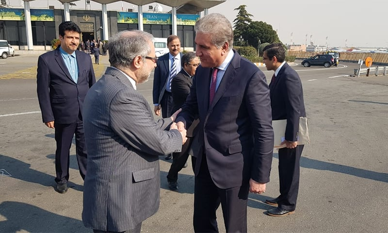 Foreign Minister Shah Mehmood Qureshi is seen off by an Iranian official upon his departure from Tehran. — Photo: FO