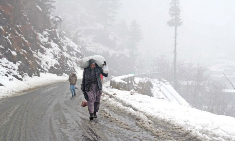 Life in Galiyat, Abbottabad come to a halt as snowfall continues. — Dawn/File