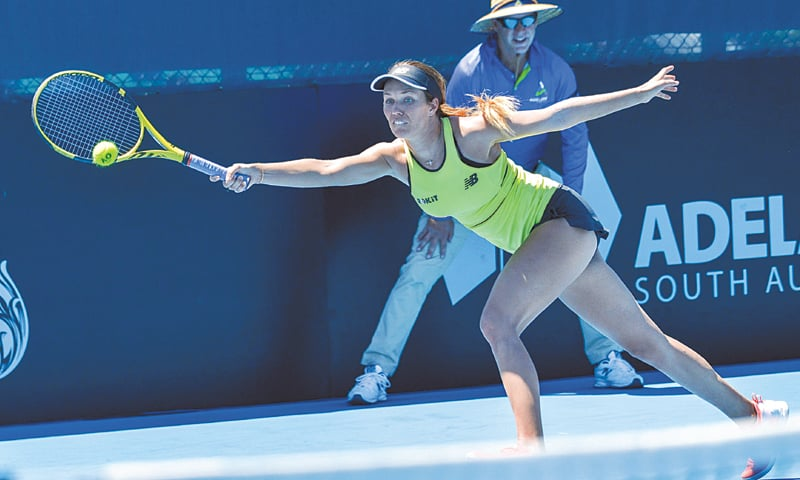 Danielle Collins of the US hits a return to Belarus' Aliaksandra Sasnovich during their first-round match at the Adelaide International on Monday.—AFP