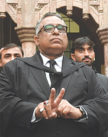 AZHAR Siddique, the lawyer for Pervez Musharraf, gestures outside the LHC building after the ruling.—M. Arif / White Star