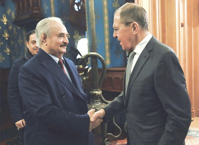 MOSCOW: Russian Foreign Minister Sergey Lavrov (right) shakes hands with Khalifa Hifter, the head of the self-styled Libyan National Army, prior to talks on Monday.—AP