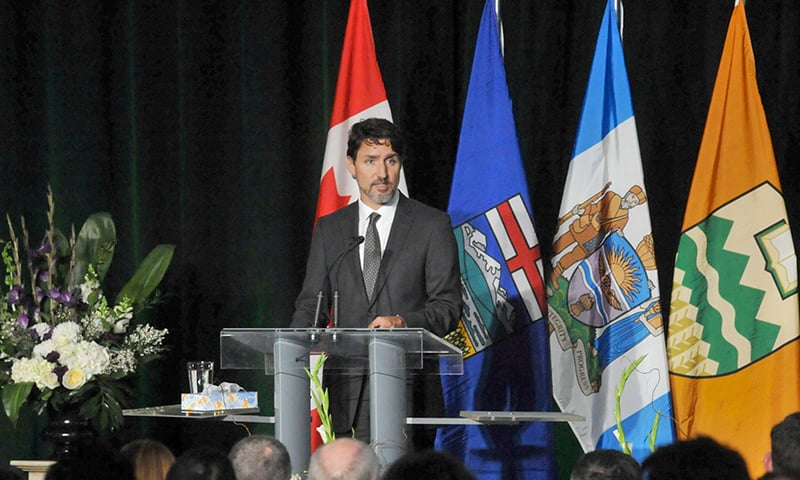 Canadian Prime Minister Justin Trudeau speaks at a memorial service for the victims of the Ukrainian Airlines flight PS752 crash in Iran at the Saville Community Sports Centre in Edmonton on January 12. — AFP