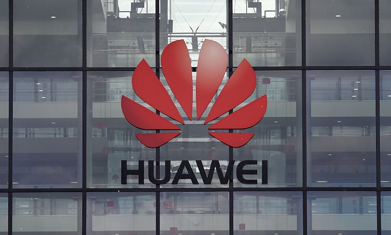 This photo taken on April 29, 2019 shows the Huawei logo and signage at their main UK offices in Reading, west of London. — AFP