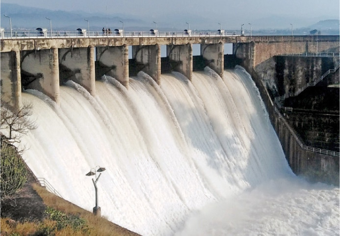 Water gushes out of Rawal Dam after its spillways were opened on Tuesday. — White Star