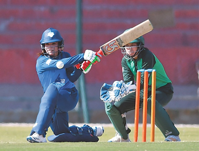 KARACHI: PCB Dynamites Sidra Amin attempts a slog sweep during her half-century knock against PCB Challengers in their match of the National Triangular T20 Women's Championship at the National Stadium on Tuesday.—Courtesy PCB