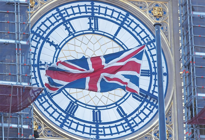 LONDON: This Dec 30 file photo shows a face of the Big Ben clock tower a day before New Year celebrations.—Reuters