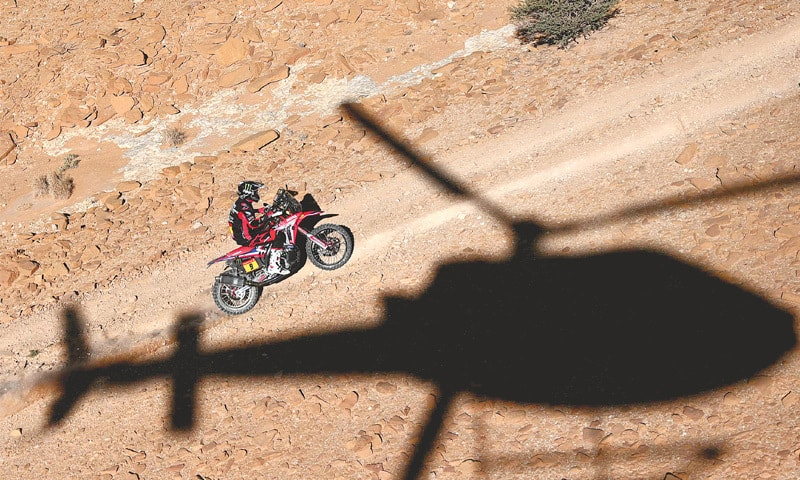 RICKY Brabec of the US powers his Honda during the ninth stage of the Dakar Rally between Wadi Al Dawasir and Haradh on Tuesday.—AFP