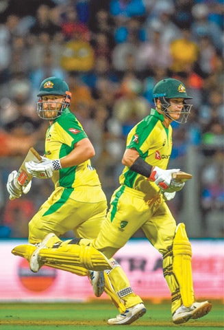 AUSTRALIAN openers Aaron Finch (L) and David Warner run between the wickets during the first ODI against India at the Wankhede Stadium on Tuesday.--AFP