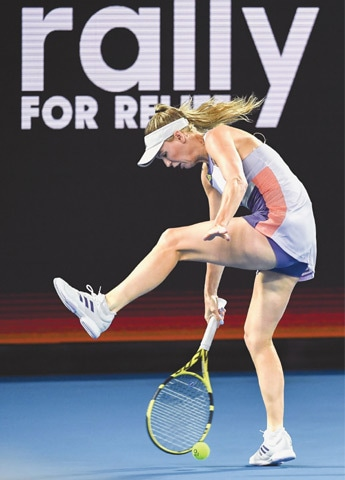 MELBOURNE: Denmark's Caroline Wozniacki plays a shot between her legs during the Rally for Relief charity match in support of the victims of Australian bushfires on Wednesday, ahead of the Australian Open.—AFP