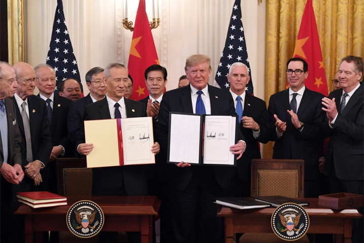 WASHINGTON: President Donald Trump and China's Vice Premier Liu He hold signed trade agreements between the two countries in White House on Wednesday.—AFP