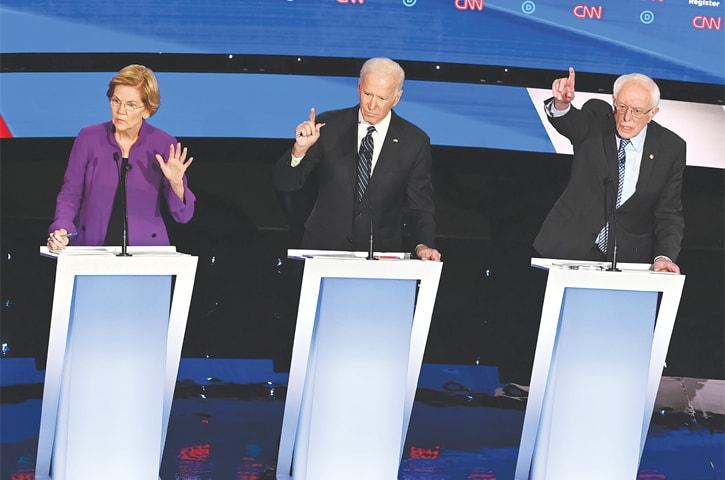 Des Moines (Iowa, US): Democratic presidential hopefuls Elizabeth Warren (left), Joe Biden (centre) and Bernie Sanders participate in the seventh Democratic primary debate on Tuesday.—AFP