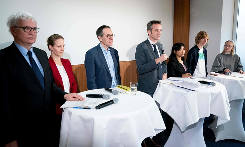 Lawyer Remo Klinger (C) speaks during a press conference organised by Greenpeace and other NGOs about climate lawsuit against German government on January 15 in Berlin. — AFP