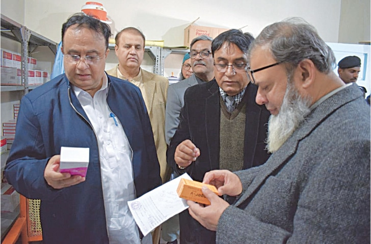 MEMBERS of the monitoring committee inspect medicines at the Mithi Civil Hospital on Thursday.—Dawn