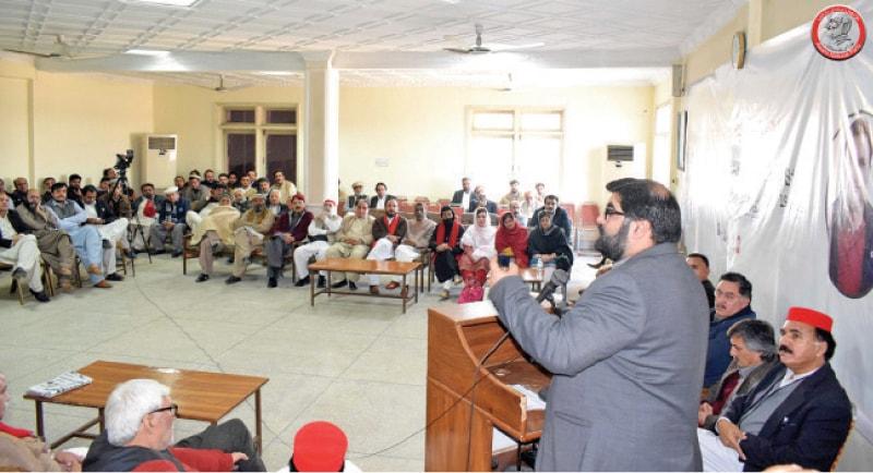 ANP provincial chief Aimal Wali addresses a gathering at Bacha Khan Markaz, Peshawar, on Thursday. — Dawn
