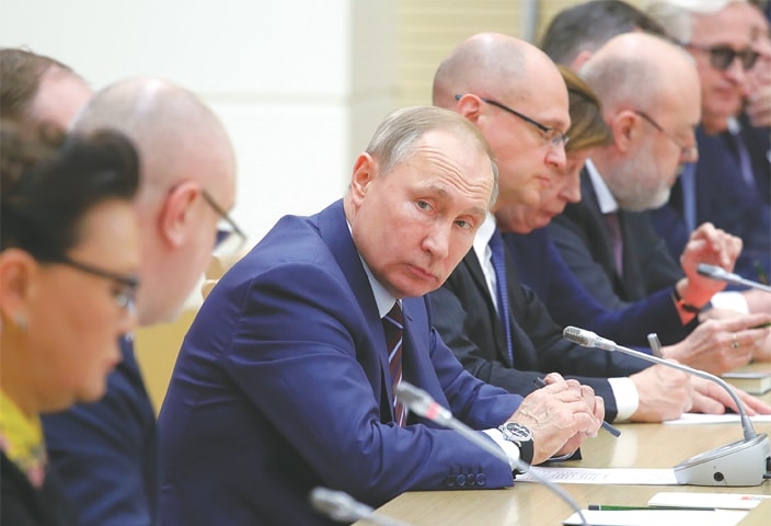 MOSCOW: Russian President Vladimir Putin attends a meeting on drafting constitutional changes at Novo-Ogaryovo, near the Russian capital, on Thursday.—AP