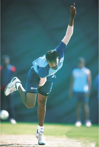RAJKOT: Indian paceman Jasprit Bumrah delivers a ball during a net practice session at the Saurashtra Cricket Association Stadium on Thursday.—AFP