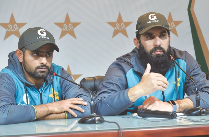 PAKISTAN'S T20 skipper Babar Azam (L) and head coach-cum-chief selector Misbah-ul-Haq attend a press conference at the Gaddafi Stadium on Thursday.—M. Arif/White Star