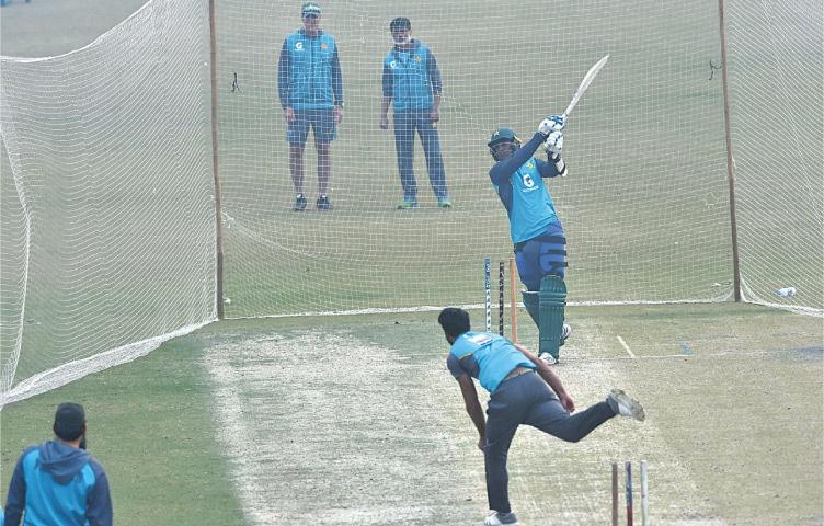 PAKISTAN cricketers undergo net practice at the Gaddafi Stadium on Friday.—M.Arif/White Star