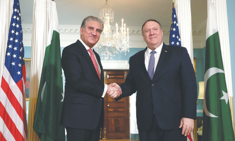 WASHINGTON: Foreign Minister Shah Mehmood Qureshi shakes hands with US Secretary of State Mike Pompeo before their meeting at the State Department on Friday.—Reuters