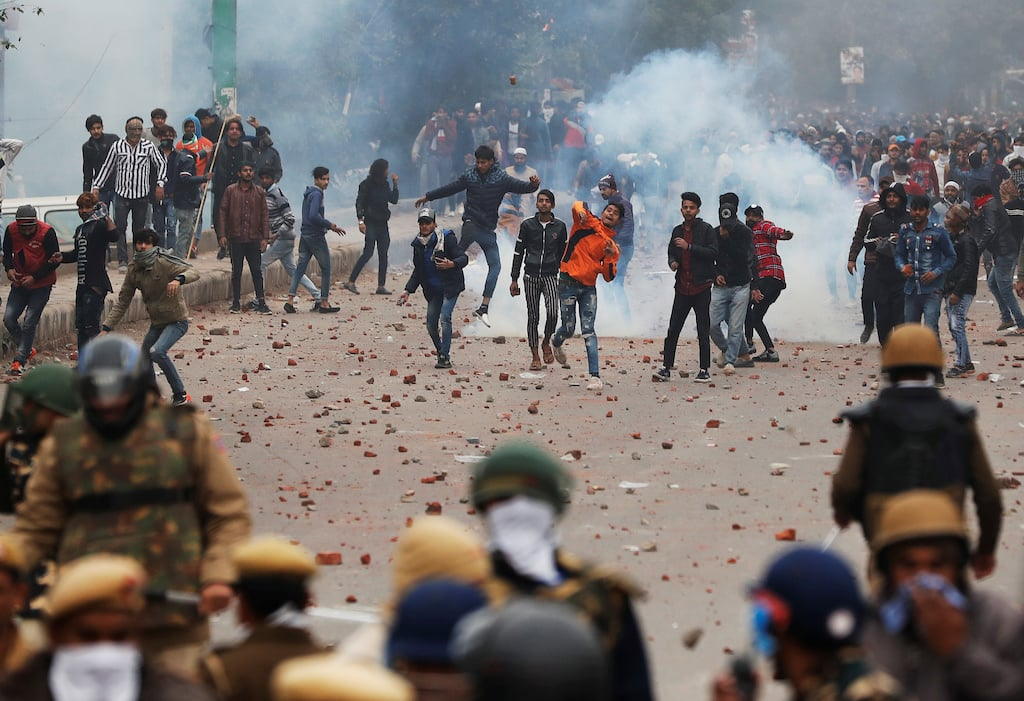 Police fires tear gas at demonstrators in Salaampur, Delhi, on December 17 | Reuters