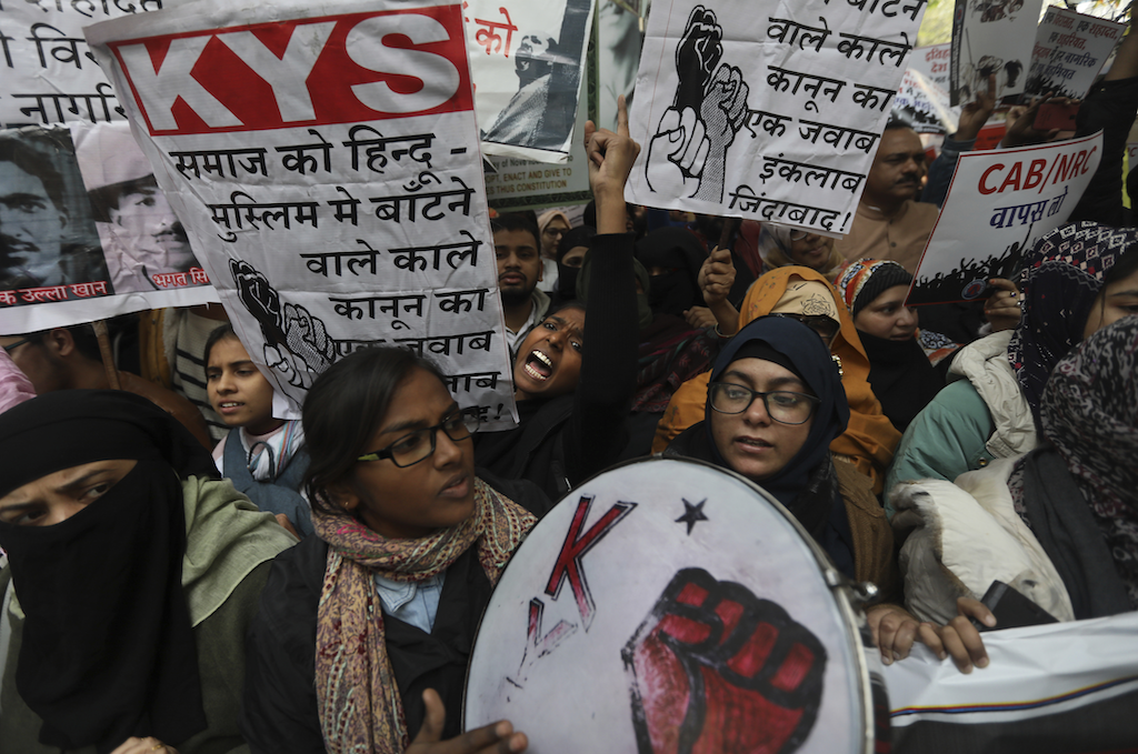 Students shout slogans against the government during a protest | AP