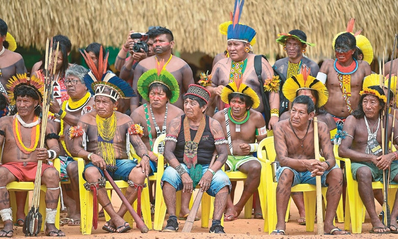 Members from different Brazilian tribes listen to their leader Cacique Raoni Metuktire (not depicted) in Mato Grosso state, Brazil.—AFP
