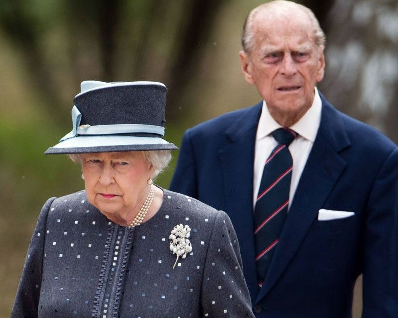 Queen Britain leaves the royal palace with husband Philip on March 19 — File Photo: AFP